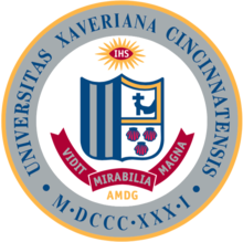 The Xavier University seal, like the St. Xavier seal, bears the schools' coat of arms, which consists of five vertical stripes, an arm holding a crucifix, and three seashells.