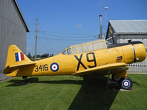 side view of restored single engine military aircraft