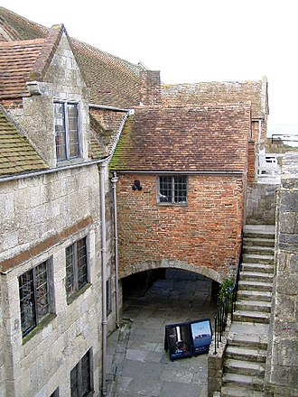 Yarmouth Castle - Looking across the courtyard at the attic and Long Room (left), a small chamber (centre) and the stairs to the platform (right)