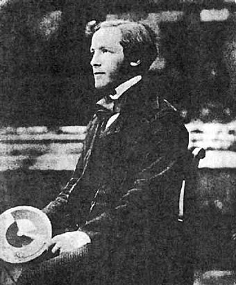 A young Maxwell at Trinity College, Cambridge. He is holding one of his colour wheels. YoungJamesClerkMaxwell.jpg
