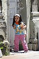 Young Girl with Doll on Street - Kars - Turkey (5815164108).jpg