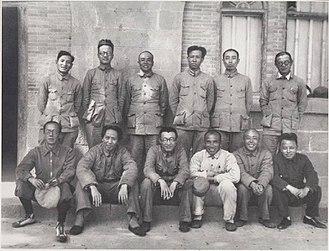 History of the Communist Party of China - The Party leadership in 1938. Front row, left to right: Kang Sheng, Mao Zedong, Wang Jiaxiang, Zhu De, Xiang Ying, Wang Ming. Back row, left to right: Chen Yun, Bo Gu, Peng Dehuai, Liu Shaoqi, Zhou Enlai, Zhang Wentian