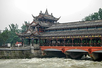 Qin dynasty - Dujiangyan, an irrigation project completed in 256 BC during the Warring States period of China by the State of Qin. It is located on the Min River (Chinese: 岷江; pinyin: Mínjiāng) in Sichuan, China, near the capital Chengdu. Although a reinforced concrete weir has replaced Li Bing's original weighted bamboo baskets, the layout of the infrastructure remains the same and is still in use today to irrigate over 5,300 square kilometers of land in the region.