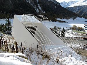 """Martin Kippenberger - Switzerland, Graubuenden, Madulain - Sculpture by Martin Kippenberger, """"Transportabler U-Bahn-Eingang"""", 2007"""