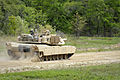 1-118th Combined Arms Battalion fires newly acquired Abrams 140414-Z-ID851-004.jpg