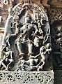 12th-century angry Shakti Devi killing demons at Shaivism Hindu temple Hoysaleswara arts Halebidu Karnataka India.jpg