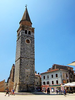 15th century bell tower of Parish church of the Assumption of the Virgin Mary and St. Peregrine in Umag.jpg