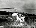 1963. Bell G-2 helicopter being loaded with Thuricide 90-T for application to a 325 acre area on Long Island. Willapa Game Rufuge, Naselle, WA. (33901432254).jpg