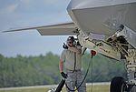 33rd AMXS Airman performs hot pit refuel on F-35 160513-F-MT297-079.jpg