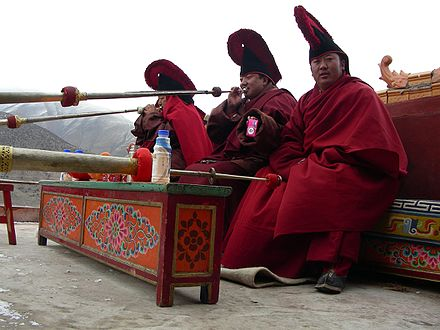 Monks playing Tibetan horns 3MonksDomthok.JPG