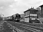46229 DUCHESS OF HAMILTON passes Settle Station signal box.jpg
