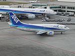ANA Wings 737-500 JA8195 at OKA (33517693175).jpg