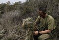 A Japan Ground Self-Defense Force (JGSDF) soldier uses vegetation to camouflage his ghillie suit while conducting a stalk exercise with the U.S. Marine Corps' 1st Marine Division Schools at Camp Pendleton 140211-M-ST621-058.jpg