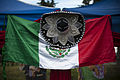 A Mexican flag is displayed during the Hispanic Heritage Month finale festival Oct 111022-F-SF570-116.jpg