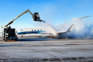 De-ice - A U.S. Gulfstream G550 gets de-iced before departing Alaska in January