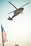 A U.S. Army UH-60 Black Hawk helicopter carrying NFL players Champ Bailey, D'Qwell Jackson, Davin Joseph, Von Miller, Steve Smith and J.J. Watt arrives at Forward Operating Base Masum Ghar in Kandahar province 130318-A-DE841-724.jpg