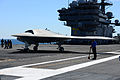 A U.S. Navy X-47B Unmanned Combat Air System demonstrator aircraft moves across the flight deck of the aircraft carrier USS George H.W. Bush (CVN 77) May 14, 2013, in the Atlantic Ocean 130514-N-TB177-361.jpg