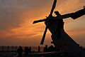 A U.S. Sailor performs maintenance on the tail rotor of an MH-60S Seahawk helicopter aboard the amphibious command ship USS Blue Ridge (LCC 19) March 26, 2014, in the East China Sea 140326-N-ZZ999-049.jpg