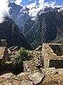 A corner of the ruins of Mach Picchu with a view of other mountains of the andes.jpg