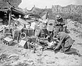 A doctor tending a wounded soldier at a Regimental Aid Post set up in a captured German ammunition dump at Oosttaverne, near Ypres, August 1917. Q5916.jpg
