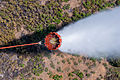 A helicopter bucket is used by a U.S. Army CH-47 Chinook helicopter crew assigned to the 2nd Battalion, 135th Aviation Regiment, Colorado Army National Guard to help fight the East Peak wildfire near La Veta 130621-Z-UA373-302.jpg
