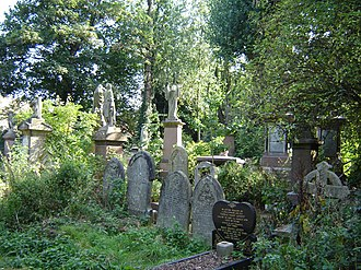 Abney Park Cemetery - Nature takes its course, as interments are rare. The grave in the foreground, dating from 1992, is an exception (September 2005).