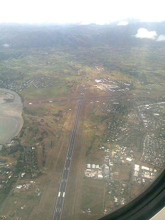 Nadi International Airport - An aerial photograph of the airport from the southwest. Runway 02 is in the middle of the photo.