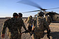Afghan National Army medics and U.S. military personnel rush a wounded Afghan soldier aboard a UH-60 Black Hawk helicopter at Forward Operating Base Delaram II in Helmand province, Afghanistan, Nov. 14, 2013 131114-M-ZB219-002.jpg