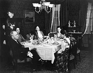 Ah, Wilderness! - Around the table in the original 1933 Broadway production of Ah, Wilderness! are (from left) George M. Cohan (Nat Miller), Eda Heinemann (Lily), Elisha Cook, Jr. (Richard), Gene Lockhart (Sid), Marjorie Marquis (Mrs. Nat Miller), Walter Vonnegut, Jr. (Tommy) and Adelaide Bean (Mildred).
