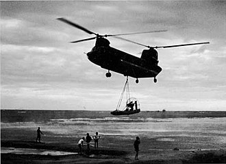 Boeing CH-47 Chinook - A CH-47 Chinook airlifts a MIKE Force Hurricane Aircat airboat from Don Phuc to the Seven Mountains in Vietnam.