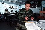 Airman 1st Class Randolph Rodriguez of Detachment 5, 5th Weather Squadron, correlates weather data in the Tactical Forecast Unit (TFU) trailer during the XVIII Airborne Corps command post Exercise Caber Dragon DF-ST-90-06165.jpg