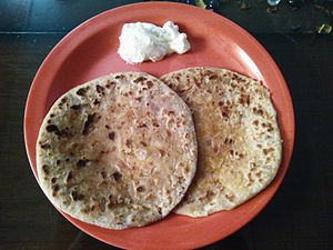 Paratha - Image: Aloo Paratha with Butter from India