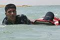 An Iraqi policeman drags a classmate through water during a rescue swimming and conditioning class in Lake Quadsiyah in Haditha, Iraq, July 9, 2008 080709-M-QJ743-009.jpg