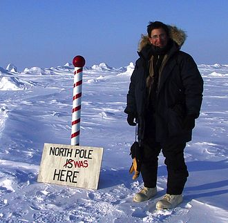 """Andrew Revkin - Andrew Revkin reported for The New York Times in 2003 from a research camp set up on sea ice drifting near the North Pole. Scientists erected the sign, then added """"was"""" as currents were pushing the ice several miles a day."""