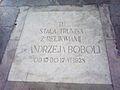 Andrzej Bobola coffin, plaque Poznan.jpg