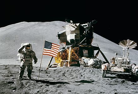 Astronaut James Irwin walking on the Moon next to Apollo 15's landing module and lunar rover in 1971 Apollo 15 flag, rover, LM, Irwin cropped.jpg