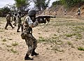 Armed Forces of Liberia (AFL) Pfc. Linton Bannie, foreground, moves tactically while engaging multiple targets downrange as Operation Onward Liberty (OOL) mentors ensure line safety during a combat marksmanship 130426-F-ED706-101.jpg
