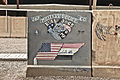 Artwork by U.S. Soldiers with the Tennessee Army National Guard's 267th Military Police Company is displayed on a blast protection barrier, known as a T-wall due to its cross-sectional shape, at Camp Liberty, in 110707-A-RC249-301.jpg