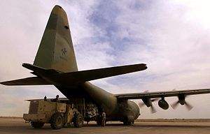 Australian Defence Force - A RAAF C-130 Hercules being unloaded at Tallil Air Base, Iraq, during April 2003