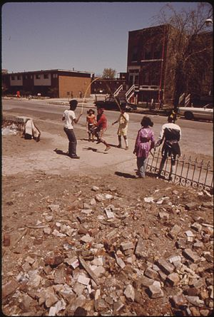 Ida B. Wells Homes - Children play outside the Ida B. Wells Homes, 1973.  Photo by John H. White.