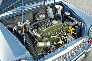 Front-engine, front-wheel-drive layout - The bonnet on this original Mini is open, showing the transversely mounted engine that drives the front wheels.