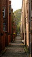 Back alley by old bus depot in Moss Side Manchester.jpg