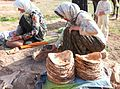 Baking bread by nomad women in Lar National Park.jpg