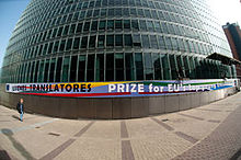 Banner for European Commission translation contest (Juvenes Translatores), displayed on EU HQ building in Brussels.