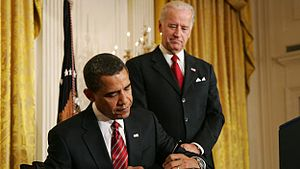 President Barack Obama signs the executive ord...