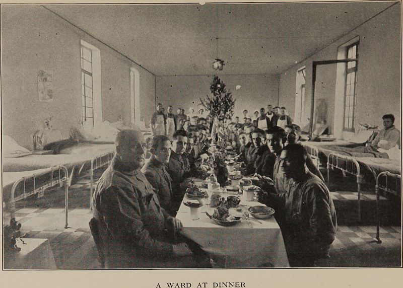 Soldiers at dinner in Base Hospital No. 9, A.E.F. -from a history of the work of the New York hospital unit during two years of active service in France.