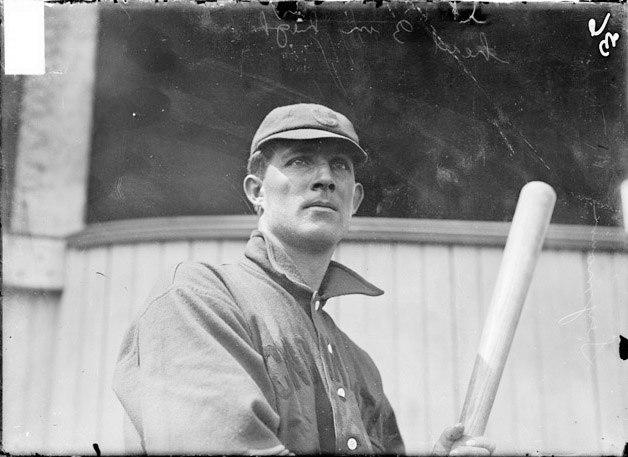 Baseball player, Cy Seymour, Cincinnati Reds, holding baseball bat, standing at West Side Grounds