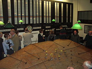 Ground-controlled interception - The restored Operations Room in the underground bunker at RAF Uxbridge showing the map and plotters and with the RAF Station names and readiness status boards on the wall behind. Also shown is the Sector clock