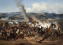 Pictură în ulei reprezentând Bătălia de la Kulm.  Din câmpul de luptă iese fum gros, un ofițer călare dă ordine