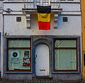 Belgian Tricolor over a Closed Storefront - panoramio.jpg